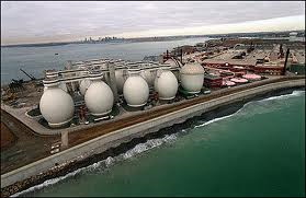 An aerial view of the 150-foot-tall egg-shaped sludge digesters at the Deer Island Sewage Treatment Plant in Boston Harbor.