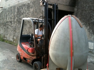 One of the egg-shaped wine vessels going into place at Domaine du Joncas.