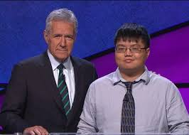 Jeopardy host Alex Trebek with contestant Arthur Chu, who won nearly $300,000 with an unorthodox style of play