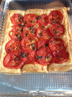 Tomato Tart with Cheese.  With Italian Seasoning mixed with olive oil drizzled on top before baking.