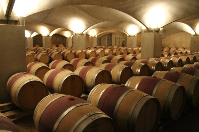 Most wineries have rooms for storing wine as it ages in barrels, although they're not all as elegant as this one, at the Château de Mercues near Cahors in France.  But they all have an intoxicating smell that's a combination of oak and wine.  If I could find a way to make my house smell like that, I would!