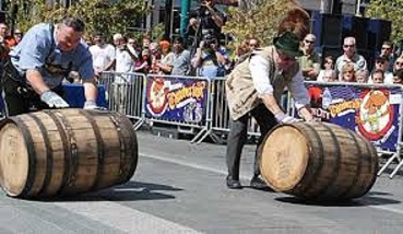 If the barrels didn't have that bulge in the middle, you couldn't roll them like this.  With or without the hats.  (Photo from octoberfestzinzinnati.com)