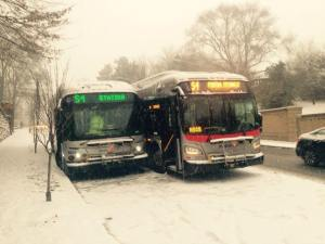 Seriously, how does this happen with just a little snow?  Two DC buses sideswiping on 16th St. NW on Tuesday.  (Photo by Bill Feldman.)