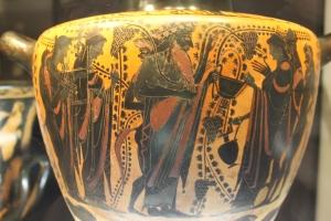 Detail from a Greek vessel, showing Dionysus entering Olympus.