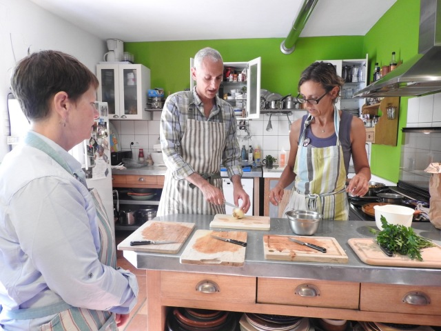 A cooking class in Provence -- Sabine Suter (right) teaches cooking in her home, and you make and eat an entire meal. Great fun, but be sure to budget about six hours! My husband Cy is in the middle doing the chopping, and Jennifer Larsen is on the left. She and Cy have been friends since kindergarten. The photo is by Kara Lenorovitz, Jennifer's wife.