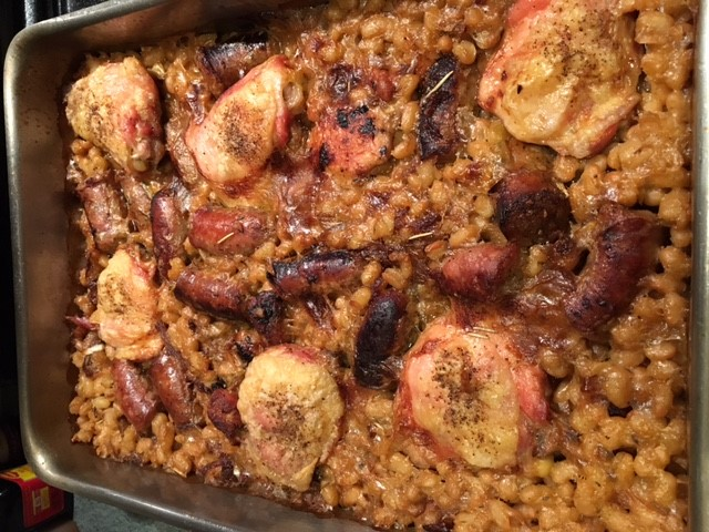 My version of cassoulet, developed from a bunch of ones I've tried, both from recipes and in restaurants. Assembling and baking it in a roasting pan concentrates flavors and allows the chicken skin to stay crisp.